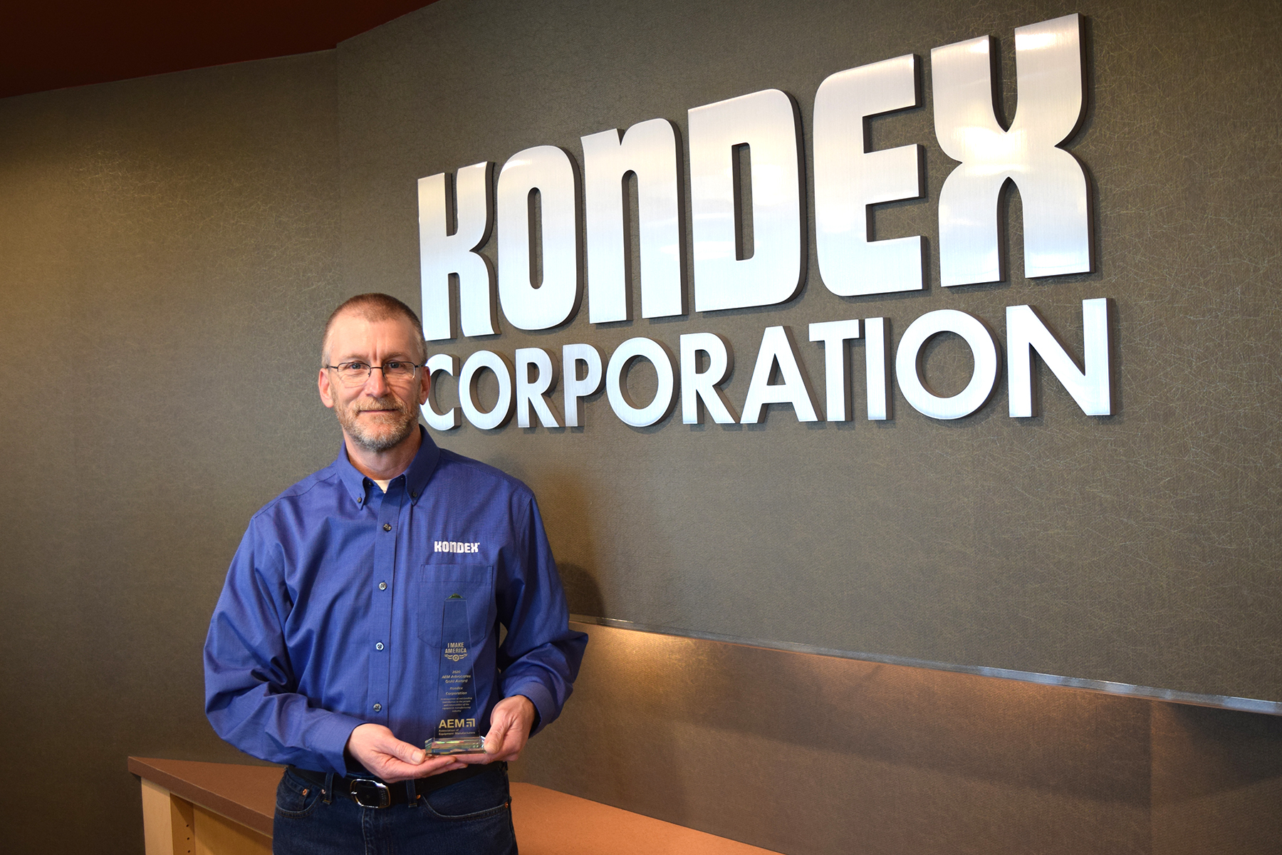 Kondex President Keith Johnson holding 2020 AEM Advocacy Gold Award
