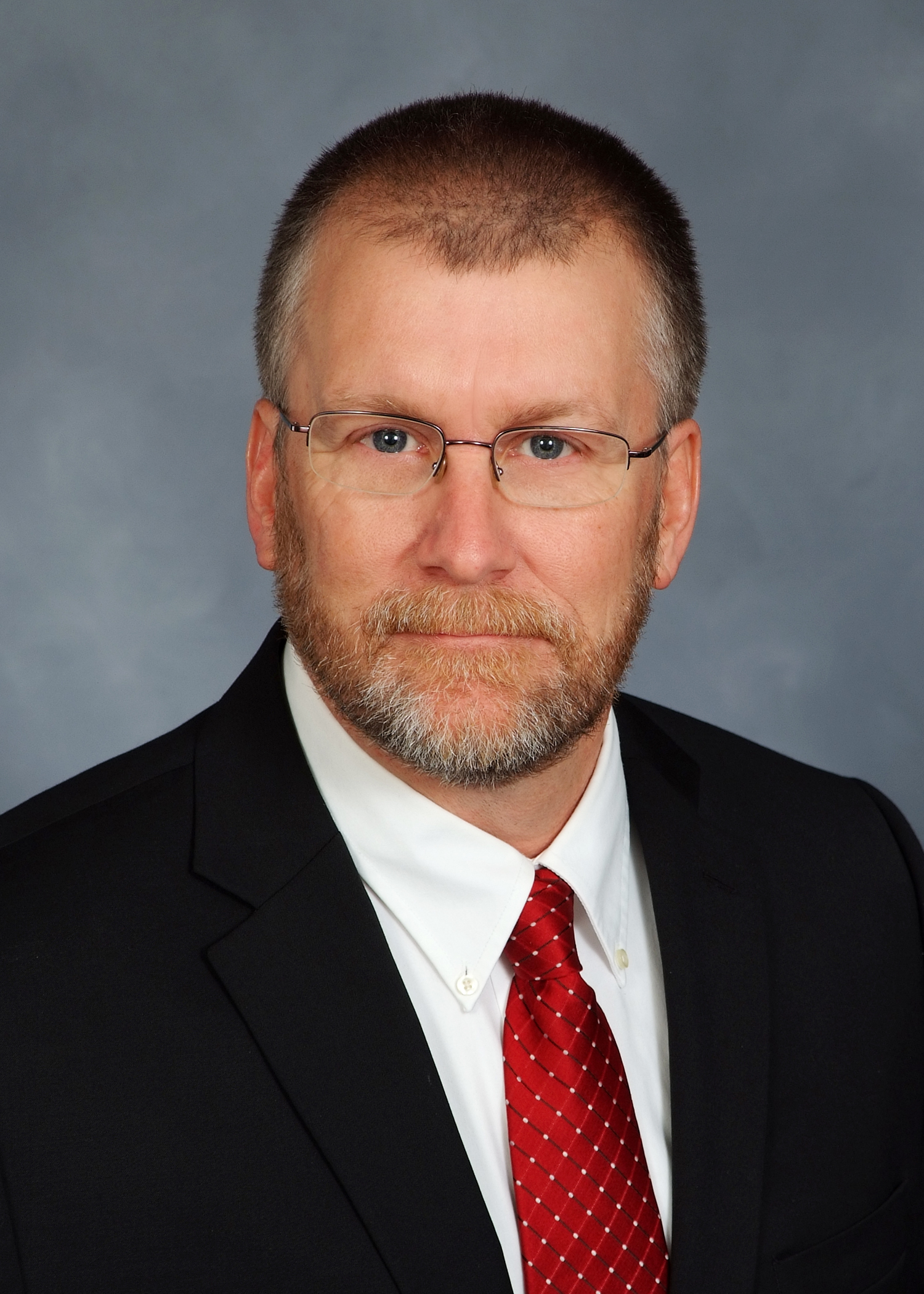 Headshot of Kondex President Keith Johnson in a suit and tie