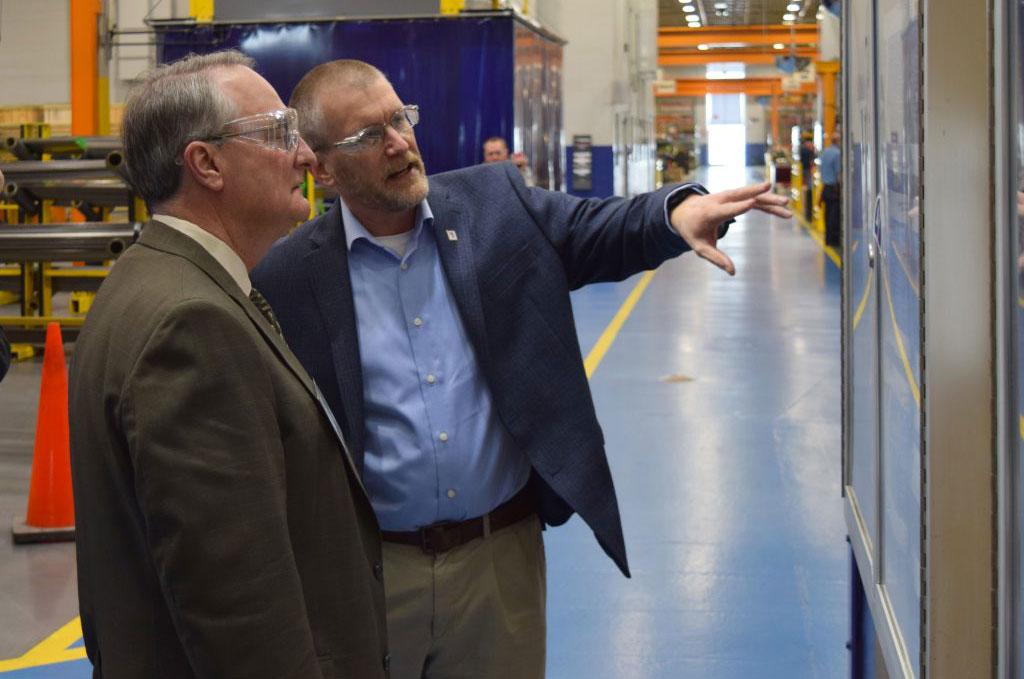 Kondex President Keith Johnson explaining production metrics to Dr. Walz