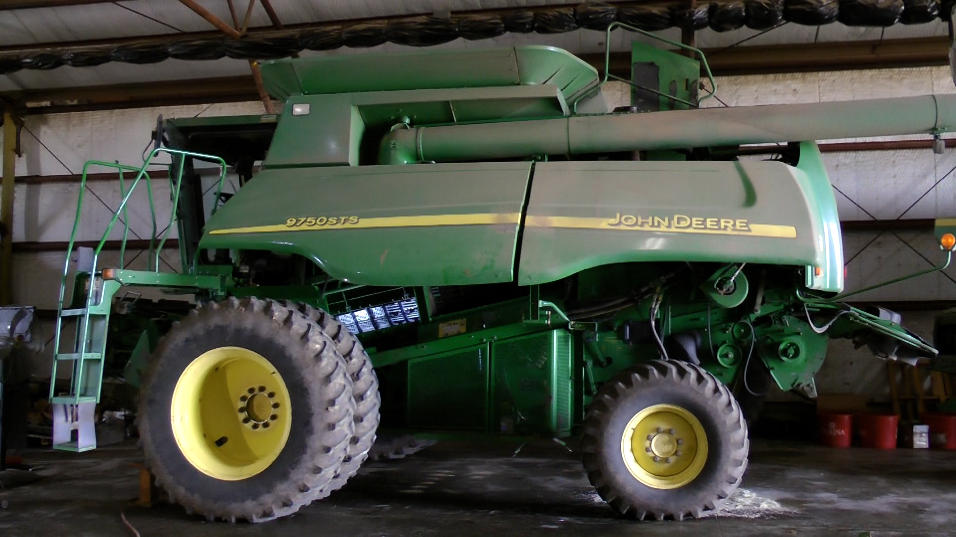 John Deere combine in shop